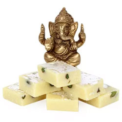 Ganesha Combo to your family and friends. This comprises of Brass Ganesha of 3 inches in size and yummy Kaju Burfi of 250 grams