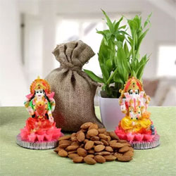 Wish your best friends and relatives with this alluring combo of two layer Bamboo plant placed 500gms almonds in a brown jute potli, Lord Ganesha and Goddess Lakshmi made from resin. Height 4 Inches