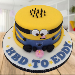 Minion Vanilla Fondant Cake This is a fantastic minion cake who is smiling cutely and ready to illuminate the birthday celebration of your kids. It is baked using the highest quality of ingredients