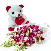 8 purple orchids beautifully arranged in a magnificent bunch along with seasonal fillers exclusively wrapped in a cellophane sheet.  along with a 8:ins cute teddy bear.