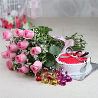 Bunch of 12 Pink Roses with Matching Ribbon Bow Tied, 1kg Round Shape Strawberry Cake, Homemade Chocolates (Weight: 100 gms)