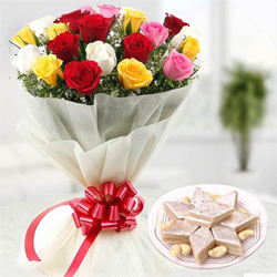12 mix coloured roses packed in an attractive paper packing along-with a pack of Half Kg yummy kaju katli sweets.
