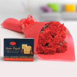 This combo contains Carnations delightfully packed in a paper.10 Red Carnations bunch Soan Papdi 500 gms