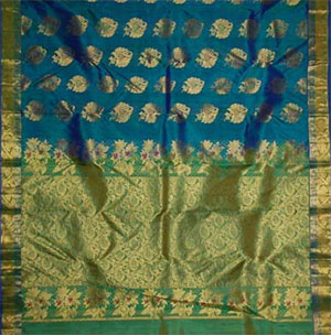 description luxgreen color kanjeevaram silk saree with mixed green and mustard zaree border body arranged with 240 buttas and pallu compactly woven with