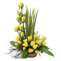 a perfect gift for cheering up a friend or loved one. Arrangement of 25 Yellow Roses in a Basket.