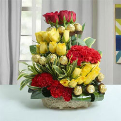 Arrangement of Ferrero Rocher Chocolates - 16 pcs., Red Roses - 6, Yellow Roses - 20, Red Carnations - 12