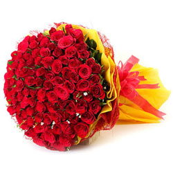 basket of 100 red roses  to kakinada