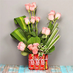 Roses and chocolates are perfect to pack a punch when any celebration Vase Arrangement of 15 Pink Roses 12 Kitket (each 18Gms