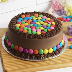 Chocolate Gems Cake 1kg  to Kakinada